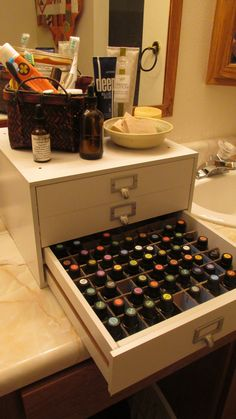 Essential oil storage solution. Upper drawers hold homemade creams, roll-ons, and books.