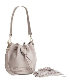 Premium-quality leather bucket bag with braided details, drawstring tassels, and detachable handle & shoulder strap. | H&M Accessories