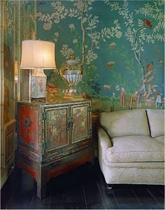 Chinoiserie room with old Chinese cabinet and turquoise wallpaper