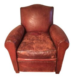 French leather club chair purchased in Paris. The leather is worn in some areas and there is a large leather patch on the seat, but this adds to its charming character.