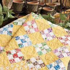 yellow and scrappy quilt    i love the yellow!