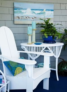 Outdoor Spaces Designed as Living Rooms are simply the best. Just bring out a few accessories for the Summer Season, including art! The all American Adirondack Chair is perfect for the laid back beach decor theme. Via Traditional Home.