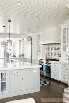 White Kitchen with island, dark hardwood floors and beadboard ceiling. Beautiful designs in this house Beautiful Kitchens, House, Home, Beach House Kitchens, Kitchen Remodel, Luxury Interior Design, Home Kitchens, Kitchen Style, Kitchen Design