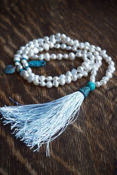 Pearl mala beads with turquoise patina sea charms and a pure silk tassel - luxurious boho jewelry at ThePillowBook Seashell Necklace, Shell Necklaces, Tassel Necklace, Pearl Necklace, Boho Jewelry, Jewelry Design, Unique Jewelry, Turquoise Fashion, Pearls