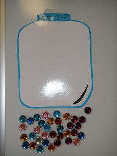 """Clutter-Free Classroom: WHOLE CLASS BEHAVIOR MANAGEMENT {Teacher Tip #26}  I LOVE this-drawn on whiteboard, uses magnets.  Much more visible than a jar that sits somewhere not easily seen.  """"marbles"""" can go in or be taken out of the 'Jar' this way."""