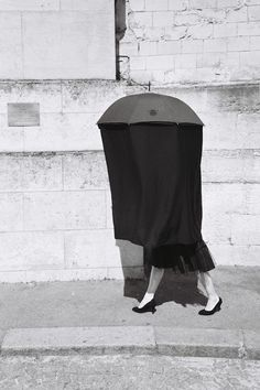 Black umbrella lady at the Père Lachaise - Paris, June 2012 Those ladies were walking around the Père Lachaise cemetery, reciting dirty poe...
