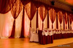 Pipe and Drape wall behind a head table using mini-light strands. Picture courtesy of Sanimar Decor Studio.