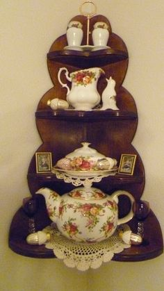 my grandpas shelf and some of my Old Country Roses  China