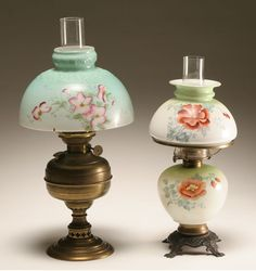 Two Victorian era oil lamps, one a St. Louis brass oil lamp with hand painted floral shade. the other with hand painted and treansfer decorated glass font and shade and white flame burner. Both with marsh burners