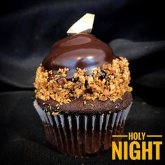 Introducing our latest Holiday flavor, HOLY NIGHT✨😈❄️  Rich chocolate-hazelnut cake, filled with chocolate ganache, frosted with chocolate-hazelnut buttercream, dipped in ganache, rolled in toasted hazelnuts, garnished with a gold chocolate shard.   #ferrerorocher #hazelnut #new #cupcake #holidays #yummy #seasonal #limited #cakery #parkave #sinisin #legalizefrostitution #feedyourgreed