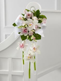 Pink and white wedding flowers for pew ends