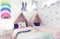 Kids in bed at last! I've been waiting until the @apartmenttherapy feature was published to you the progress of the girls' room. The 'brief' from Lily was 'RAINBOW!!' and my husband made the bedheads from plywood. : @hayleygemma