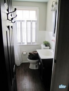 dark wood floors in a bathroom. love this, even if it's not practical.