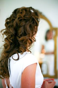 Half-up Wedding Hair & Beauty Photos & Pictures - WeddingWire.com - I love the big, lose curls but not sure how I'd work my veil into that.