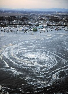 Japan Tsunami - Vortex - this really did happen, this isn't photo shopped
