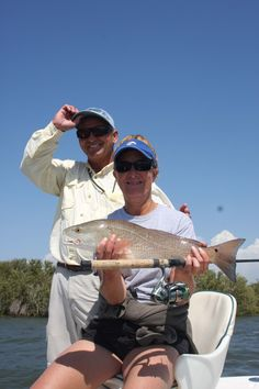 Capt. Rick LeFiles and Sue Cocking with a Withlacoochee redfish.