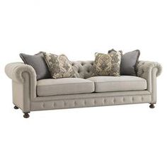 """Button-tufted sofa with down cushioning and matching accent pillows.  Product: SofaConstruction Material: Fabric and woodColor: GrayFeatures: Includes four throw pillowsDimensions: 31.25"""" H x 99"""" W x 42"""" D"""