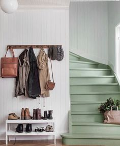 Green stairs, functional entryway, coat rack and shoe table. But mostly I love those stairs!!