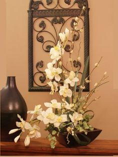 i really like orchids. I can'y keep real ones alive, so maybe i should try silk ones instead.