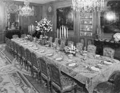 The Dining Room at Hillwood in Washington, DC set with a lace table cloth.  Hillwood is the home of Marjorie Merrieweather Post