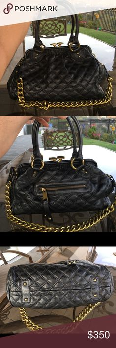 Marc Jacobs Stam black leather Bag Satchel Auth. Marc Jacobs black leather Stam Satchel quilted bag  with kiss lock closure. The bag is sold out everywhere it was discontinued last year and it's considered collector peace. The bag is been purchased from Neiman Marcus and it's been used handful of times. From smoke free and pet free home. Marc Jacobs Bags Satchels