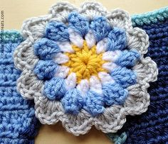 Free pattern for the Crafternoon Treats large flower. A 4-inch diameter flower that's easy to crochet in whatever colourway you like. Can be used as an embellishment in many different situations - on hats, bags, scarves, garments or teamed with triangular pennants to make bunting.