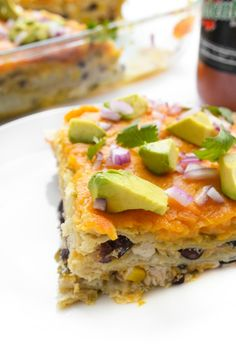 A fun spin on the traditional Italian dish, this naturally gluten free cheesy Mexican lasagna recipe is made with shredded chicken, black beans and corn.