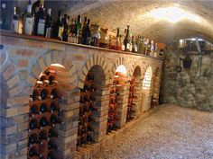 Old World Rustic Wine Cellars- gorgeous way to use a fireplace too!!