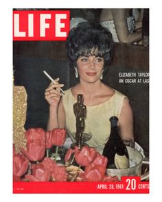 Elizabeth Taylor with her Academy Award at an Oscar Party Following her Win - April 28, 1961