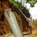 "BERRY PICKER    This berry picker is made out of PVC pipe. Heat is used to shape the plastic. Two ""fingers"" at the working end do the picking. The berry then falls through the pipe and lands in a plastic bag tied to the other end."