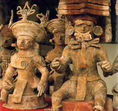 Two of the twelve ruler effigies (censer lids) found outside of Ruler 12's tomb in the Ancient Mayan archaeological site of Copán, Honduras.