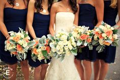fall wedding, navy bridesmaid dresses, orange roses, white roses, dusty miller....this, but minus the green plants