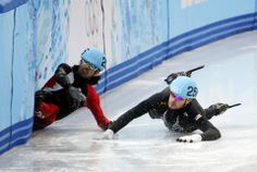 DAY 9:  Charles Hamelin of Canada and Eduardo Alvarez of the United States crash out during the Short Track Men's 1000m http://sports.yahoo.com/olympics