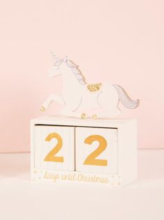 Princess Unicorn Christmas Countdown Block £10 - This Christmas we create a magical world of fairy tales and fantastical opulence with the Wonderland collection. Utterly enchanting, this range features an array of unique and iconic characters including flamingos and unicorns. Fit for princesses all over the land, the pastel pink colourway with touches of glitter and jewels creates a dreamy and feminine aesthetic.
