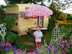 Pretty bed sheet over outdoor umbrella and tied at corners.. what a really cute idea!  I'm doing this!!!