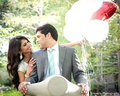 An newly engaged Indian couple take some outdoor portraits. They choose a mix of casual, formal, and traditional ensembles.
