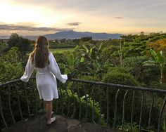 10 Luxury Eco-Resorts to visit - woman on balcony at Finca Rosa Blanca Country Inn in Costa Rica...  I've been to an eco-resort in Ecuador and it was amazing.  I would do it again!