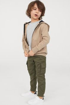 Cargo pants in soft, stretch cotton twill with an elasticized drawstring waistband and mock fly. Welt side pockets, leg pockets with flap and hook-loop fast Little Man Style, Little Kid Fashion, Toddler Boy Fashion, Cute Kids Fashion, Fashion Children, Toddler Girl, Girl Fashion, Baby Boy Swag, Kid Swag