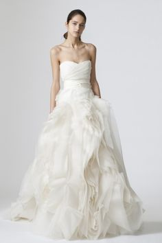 Ivory strapless organza sweetheart gown with tulle draped bodice, swirling tissue organza flange skirt, and ivory double-knotted tie at waist