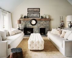Fireplace Photo - A tufted upholstered ottoman paired with two couches