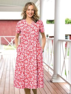 Womens Knit Skimmer Dress with lightly shirred empire waist, button front and bold floral and solid color print. Summer soft cotton knit dress popular for warmer weather.