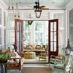 what is not to love in this picture?? A few of my favorites : hanging swing, light blue ceiling, gorgeous floor to ceiling windows, mahogany double door to gorgeous sun room. Trying to figure out how I can make this happen in my house.......Image from Southern Living