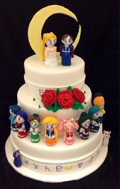 My friends are insanely talented. Check out this Sailor Moon wedding cake by Kalika K.B. Geek chic or what?!?