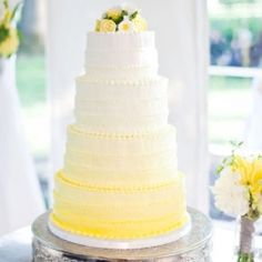 White wedding cake with a tiny touch of color. Like the design but with different flowers on top and different color