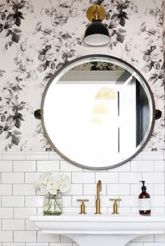 Something about the combination of a round mirror, a single wall sconce, and subway tile (dark grout preferred but not required) feels both very classic but also very now. And as bathroom looks go, it's also very budget-friendly.