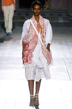 The complete Dries Van Noten Spring 2003 Ready-to-Wear fashion show now on Vogue Runway.