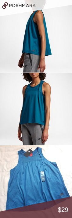NWT Nike Nike Women Sz Small top. NWT Nike Nike Women Sz Small top. Indusrial dark blue/black.  Orig. $60 ALL-DAY COMFORT  The soft and flowy Nike Sportswear Bonded Women's Tank features breathable mesh panels for extra comfort and cooling.  Benefits -Breathable mesh panels at center chest and back pleatDropped back hem enhances coverage  Product Details -Fabric: Body: 100% cotton. Mesh: 81% nylon/19% spandex. -Machine wash Nike Tops Tank Tops