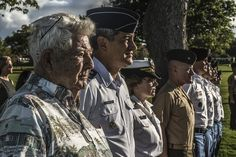 Ray Emory, Air Force Maj. Gen. Kelley K. McKeague, Navy Rear Adm. Kathy Creighton and members of the Defense POW/MIA Accounting Agency participate in a disinterment ceremony at the National Memorial Cemetery of the Pacific in Honolulu, June 8, 2015. The agency conducts disinterments to identify U.S. service members from the USS Oklahoma buried as unknowns. MeKeague is the agency's deputy director and Emory is a Pearl Harbor survivor.