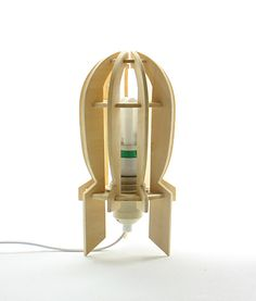 DIY wood rocket lamp really rocks! Wooden Desk Lamp, Wood Lamps, Table Lamps, Diy Luz, Rocket Lamp, Laser Cut Lamps, Buy Wood, Led Lampe, Wooden Diy