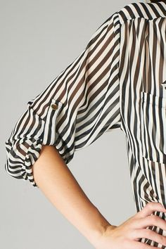 sheer striped blouse.